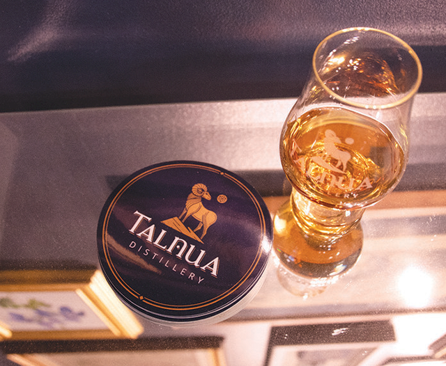Whiskey in a dram with the Talnua logo on the side
