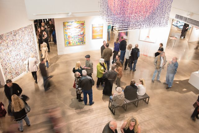 Seen from above, patrons explore the Center's Main Gallery during a gallery opening